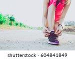 young asian woman wearing pink... | Shutterstock . vector #604841849