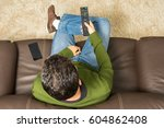 man watches television alone... | Shutterstock . vector #604862408