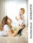 mom with a baby eleven months... | Shutterstock . vector #604863950
