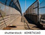 urban chain link fence walkway. ... | Shutterstock . vector #604876160