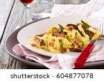 italian pasta carbonara with... | Shutterstock . vector #604877078