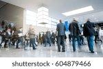 trade fair visitors rushing in... | Shutterstock . vector #604879466
