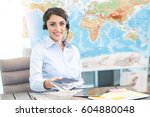 young woman travel agent concept | Shutterstock . vector #604880048