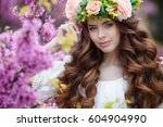 spring woman in flowers.... | Shutterstock . vector #604904990