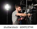the lighting engineer adjusts... | Shutterstock . vector #604913744