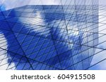 glass wall reflecting blue sky... | Shutterstock . vector #604915508