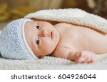 the baby lies on the bed | Shutterstock . vector #604926044