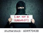 muslim girl in black hijab... | Shutterstock . vector #604970438