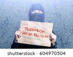 muslim girl in black hijab... | Shutterstock . vector #604970504