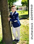 smiling boy standing near a... | Shutterstock . vector #604999949
