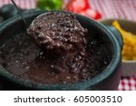 a pan filled with hot... | Shutterstock . vector #605003510