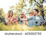 happy young friends having... | Shutterstock . vector #605003750