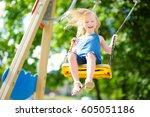 cute little girl having fun on... | Shutterstock . vector #605051186