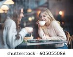 two girl friends drinking... | Shutterstock . vector #605055086