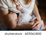 newborn baby being breastfed by ...   Shutterstock . vector #605061800