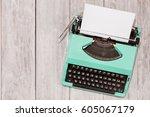 retro old mint green typewriter ... | Shutterstock . vector #605067179