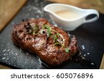 new york steak with sauce seved ... | Shutterstock . vector #605076896