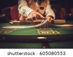 Croupier behind gambling table...