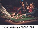 upper class friends gambling in ... | Shutterstock . vector #605081384
