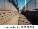 urban chain link fence walkway. ... | Shutterstock . vector #605088734
