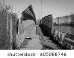 urban chain link fence walkway. ... | Shutterstock . vector #605088746