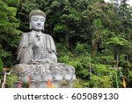 giant rock buddha statue in... | Shutterstock . vector #605089130