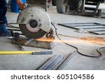 mechanic use cut off saw... | Shutterstock . vector #605104586