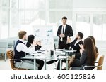 business team gives a... | Shutterstock . vector #605125826