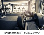 rows of dumbbells in the gym... | Shutterstock . vector #605126990