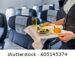 served lunch in aircraft  | Shutterstock . vector #605145374
