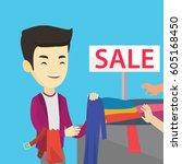 asian smiling man choosing... | Shutterstock .eps vector #605168450