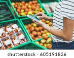 young woman shopping healthy... | Shutterstock . vector #605191826