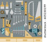 set of tools hanging on peg... | Shutterstock .eps vector #605230199