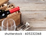 red wine bottle and glasses on... | Shutterstock . vector #605232368