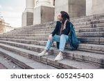 fashion model wearing ripped... | Shutterstock . vector #605245403