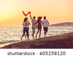 group of happy young people is... | Shutterstock . vector #605258120