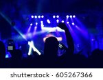 crowd rocking during a concert... | Shutterstock . vector #605267366