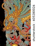 dragon sculptured wood | Shutterstock . vector #605280026