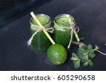 fresh smoothie in glass over... | Shutterstock . vector #605290658