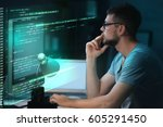 Small photo of Program development concept. Young man working with computer