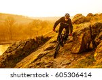 enduro cyclist riding the... | Shutterstock . vector #605306414