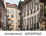 colorful houses in milan  italy. | Shutterstock . vector #605309360
