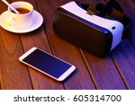 vr glasses and cell phone on... | Shutterstock . vector #605314700