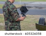 Soldier Holding Remote...