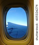 Small photo of view airplane wing from the airplane window