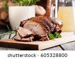 roasted shoulder of pork on a...