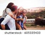 happy group of friends enjoying ... | Shutterstock . vector #605335433