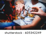 two hands clink glasses of... | Shutterstock . vector #605342249