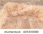 Small photo of Bright Natural wood shaving wool curls on wooden uncouth Board, rustic background, copy space