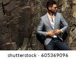 man in elegant suite posing in...   Shutterstock . vector #605369096